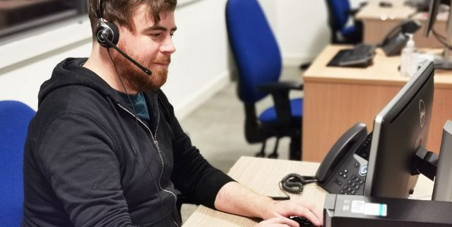 Call handler Freddie Irvin is at his desk taking calls for the NHS 111 service in Norfolk