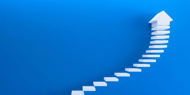 An image of steps leading upwards to indicate progress