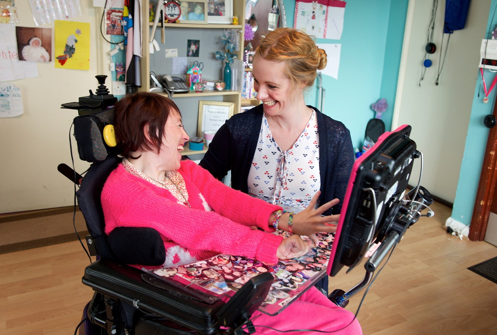 Wheelchair user and carer using computer