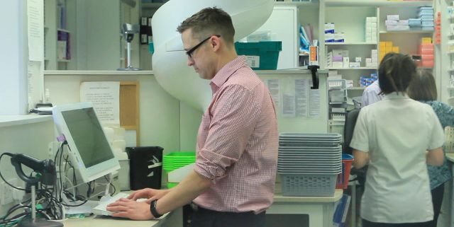 Pharmacist Paul Rolfe at work using the Real Time Exemption Checking system
