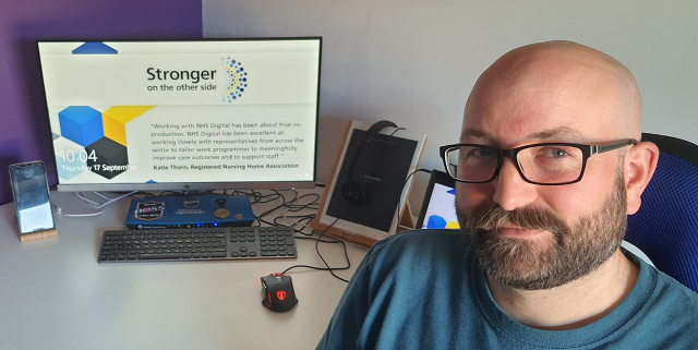 Photo of Simon Dyson in front of his computer at home.
