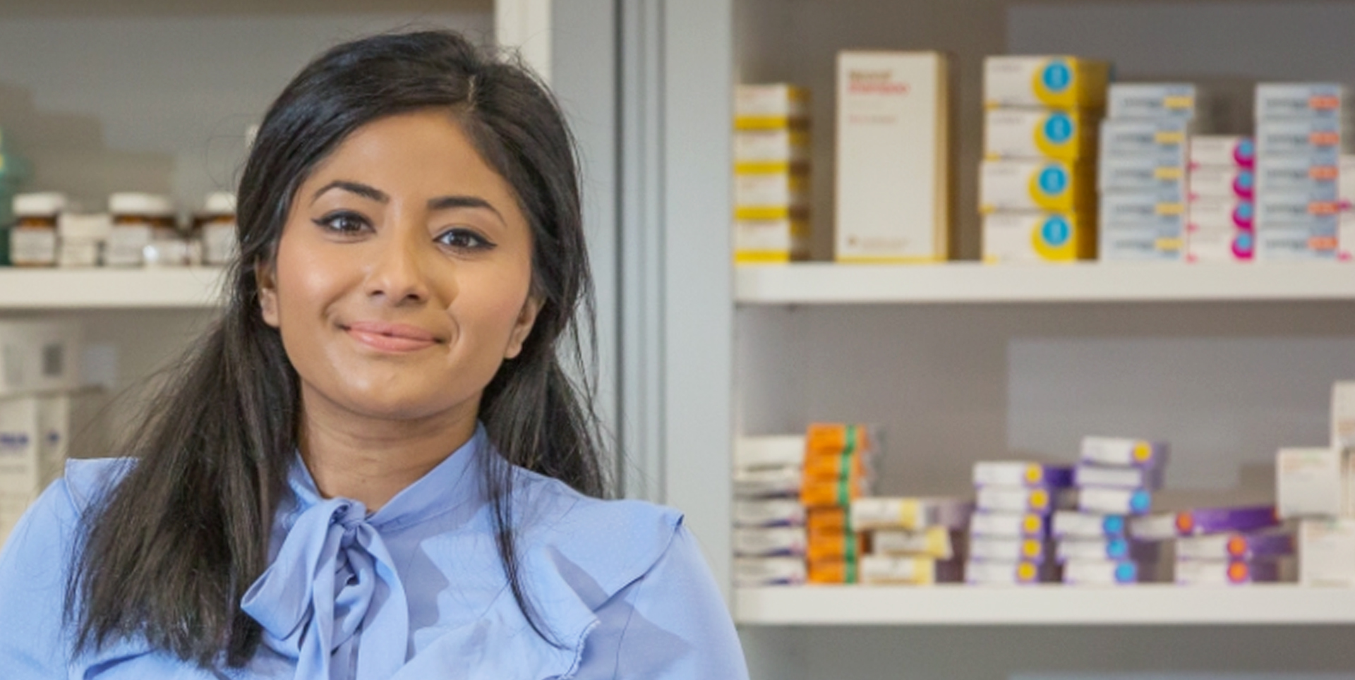 Photo of Tahmina Rokib, Clinical Lead for Digital Medicines at NHS Digital, in a pharmacy