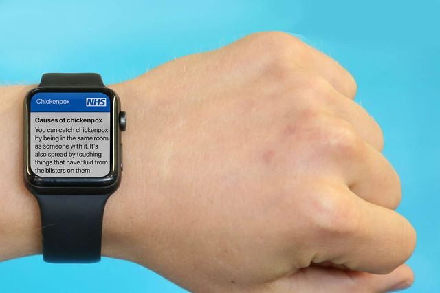 A person looking at the NHS chickenpox content on a smart watch