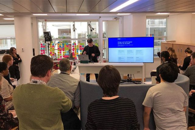Picture of Ian Roddis presenting a digital service manual show and tell