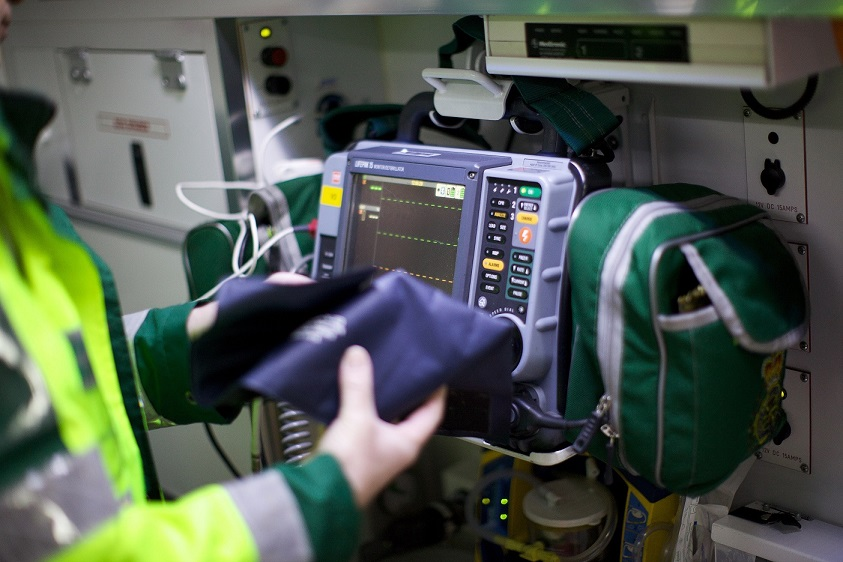 Paramedic operating Lifepak 15 monitor in ambulance